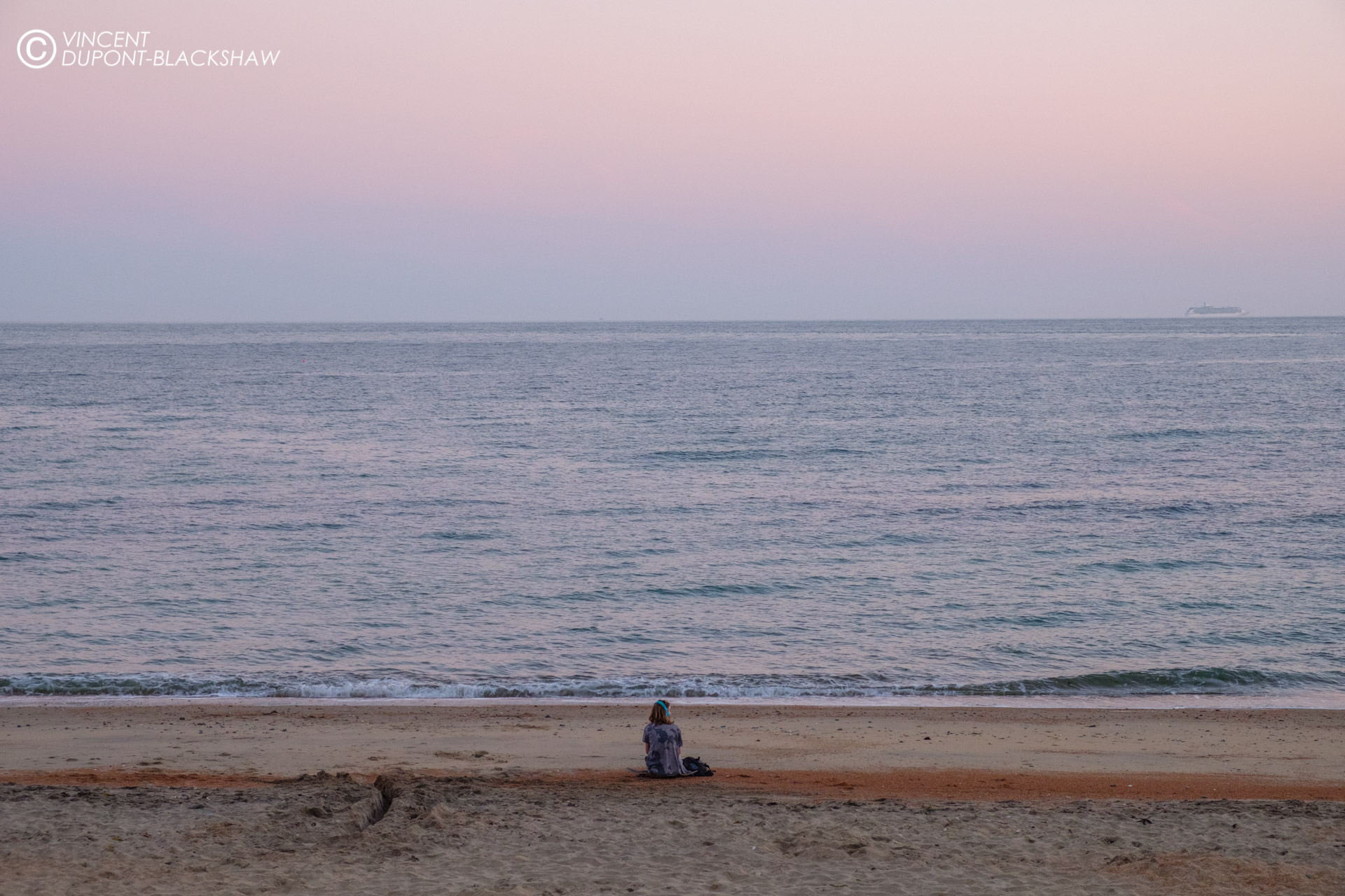Grounded /// A men with headphones on the beach at dusk. (Ventnor)